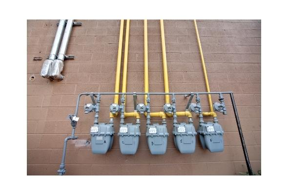 a set of gas meters on the exterior of a building